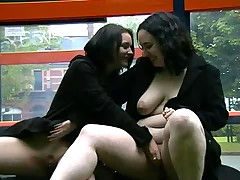 Still at the bus stop Nimue and Pixie strip off and make out in front of passing traffic and busses, culminating in Nimue giving Pixie a spanking in the street.